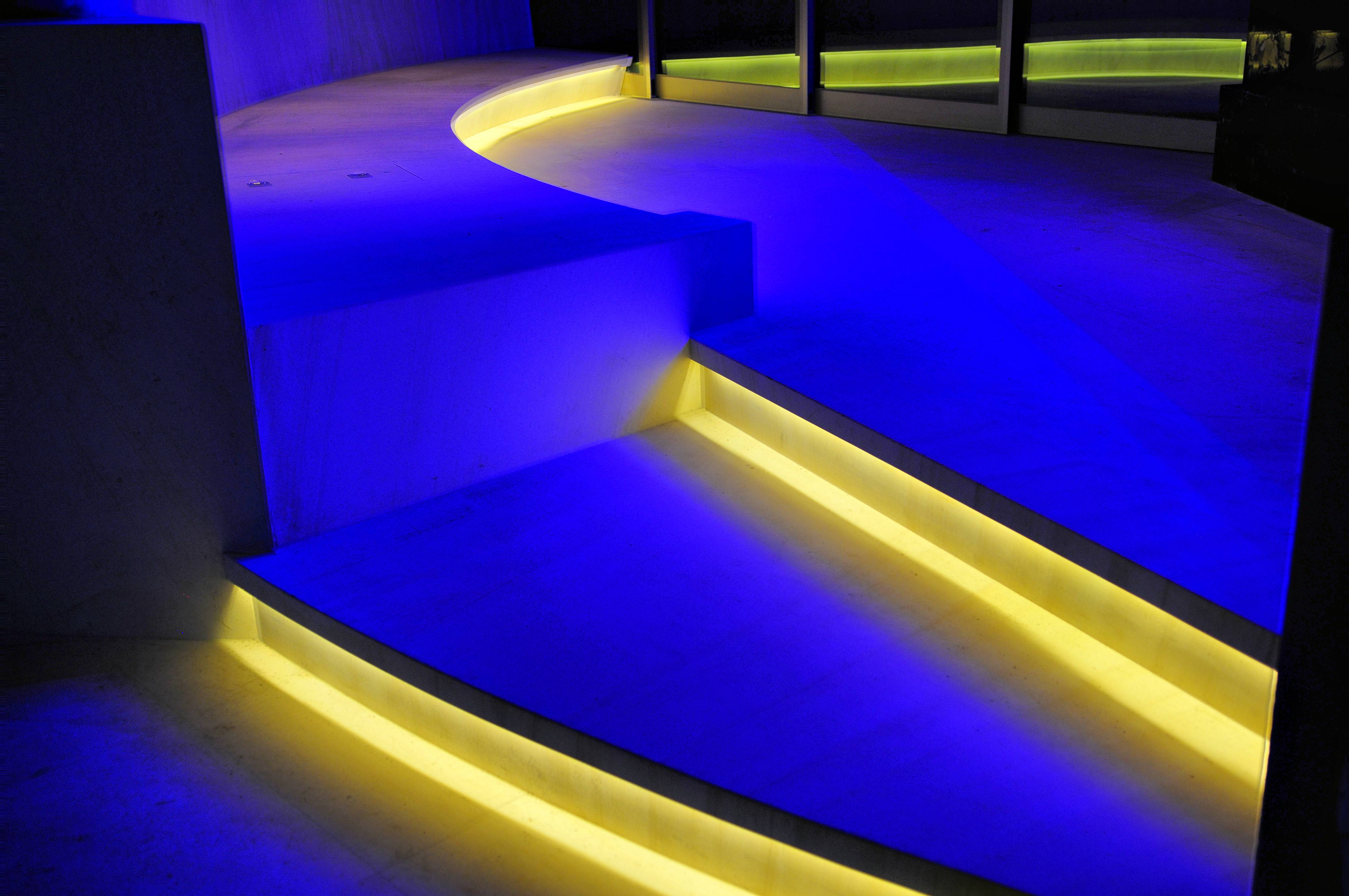 Stairwell lit by colored LED lights